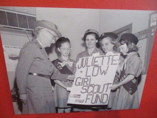 A photo from Paterson Museum exhibit of young Girl Scouts with Miss Dora Goodbody (left), who founded the program in Paterson in 1919.