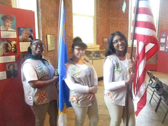 Paterson Girl Scout members Mya Floyd, Sophia Savage, and Emanik Legette t the oranization's 100-year celebration held at the Paterson Museum.