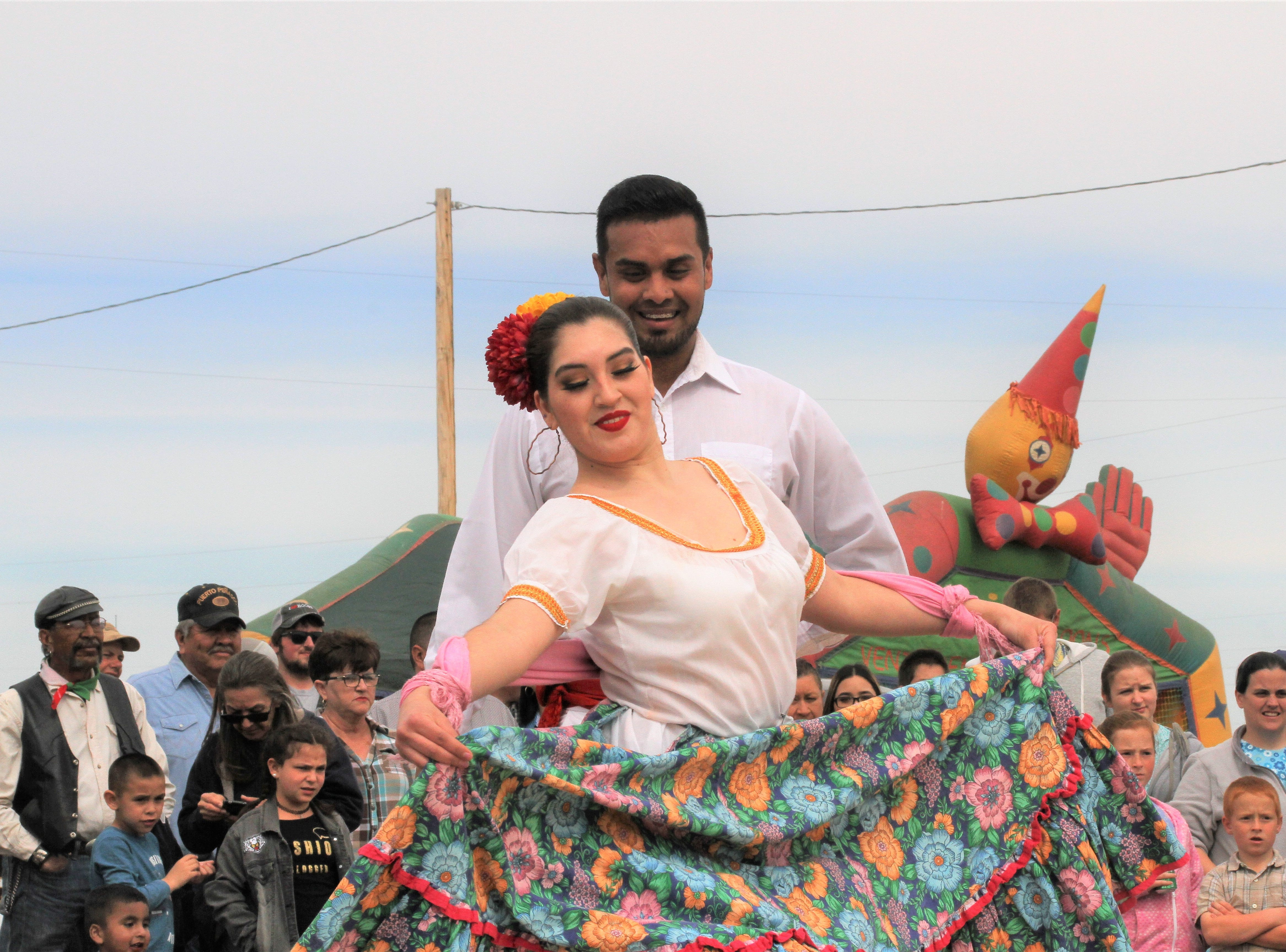 Professional dancers Yire Tellez and her partner Joel Jurado, from the University de Autonoma de Chihuahua, perform balet folklorico.