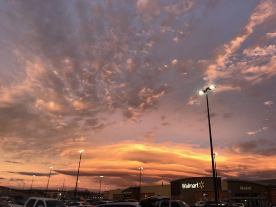 As seen from Walmart on Rinconada Boulevard, pancake-like clouds hover over the Organ Mountains at sunset on Sunday, March 10, 2019.