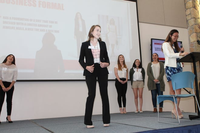 Members of New Mexico State University Alpha Xi Delta Sorority demonstrated business fashion, from formal attire to casual Friday dress, during the third Dream It, Be It Girls' Conferenceon Feb.9 in Las Cruces.