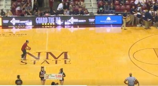 Mike Garcia takes a shot from half court during the New Mexico State men's basketball game on Saturday, March 9, 2019, at the Pan American Center. Garcia nailed the shot to win $5,000.