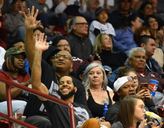 Johnny McCants Sr., top, attends most of the Aggies home games with eldest son, Daemund McCants.
