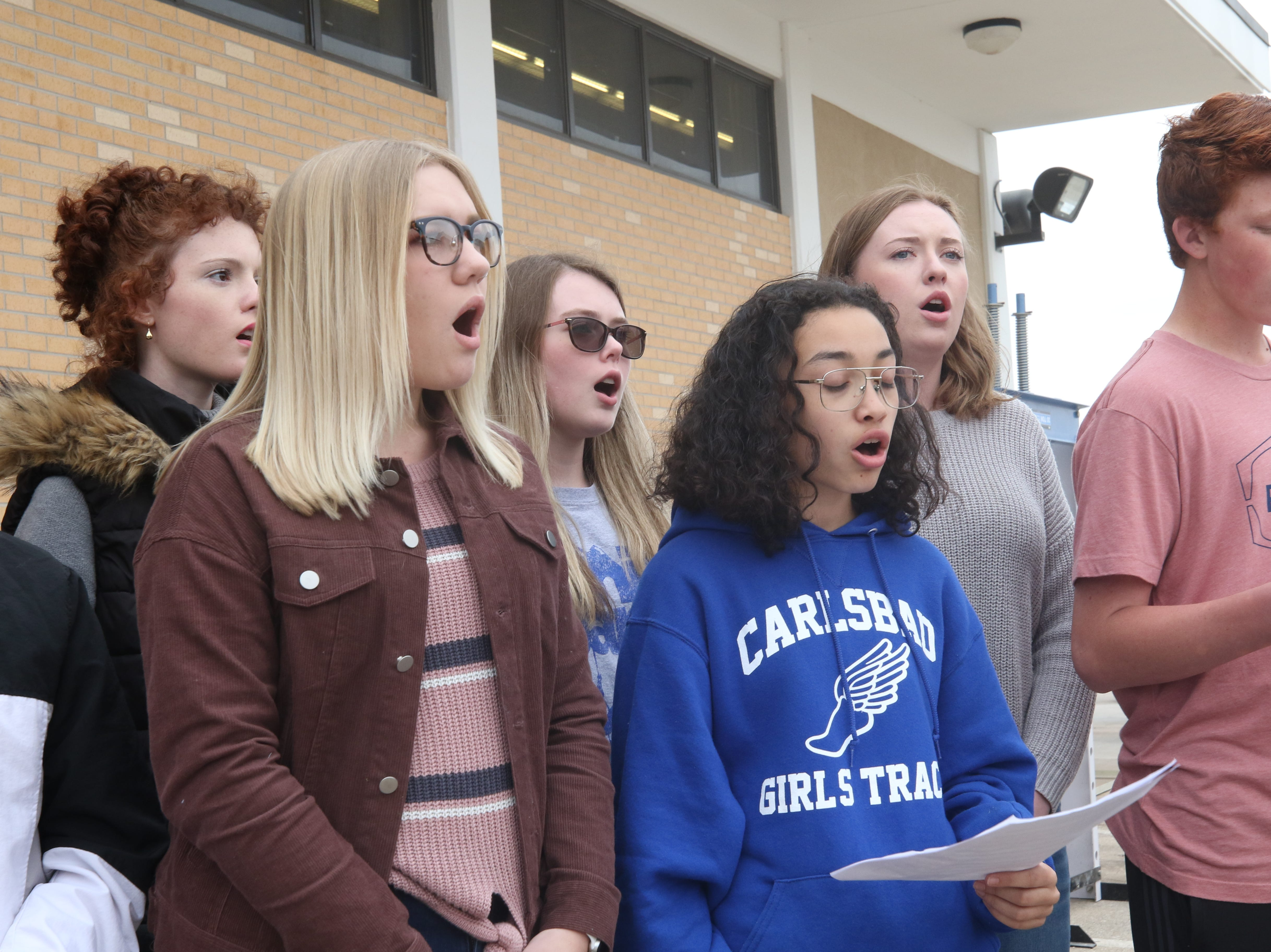 Members Carlsbad High School's choir sing during a ceremony to accept an equipment donation from XTO Energy, March 11, 2019 at Carlsbad High School.