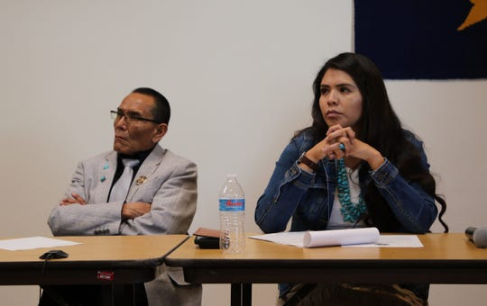 Navajo Nation Council Delegates Pernell Halona, left, and Charlaine Tso listen to a public comment on Sunday at the town hall meeting at the Kayenta Township building in Kayenta, Ariz.