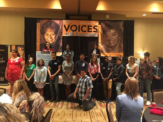 Roberta Rael (behind the podium) accepts the Spirit of Hope Direct Service Award for her work founding and directing Generation Justice, a youth-led radio show at KUNM. Roberta is surrounded by the Generation Justice youth who were attending the awards luncheon, which was part of our 2018 KIDS COUNT Conference.