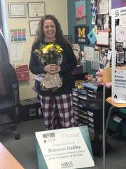 Shannon Hadley, an ESL teacher at Novi High School, learns she is the Novi Teacher of the Year on Monday, March 11, 2019.
