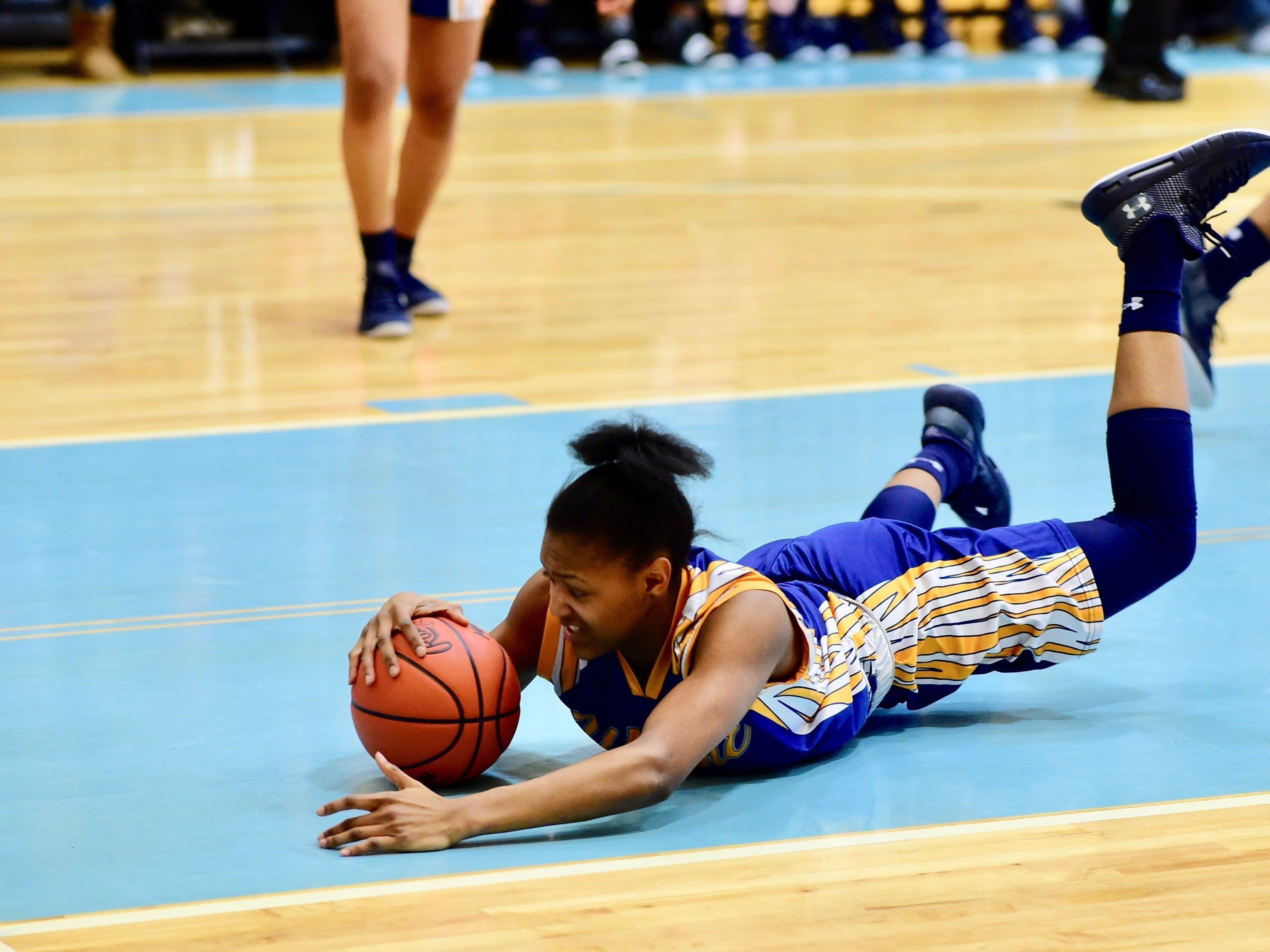 Wayne's Jayah Hicks dives on a loose ball against Mercy on March 11, 2019.