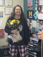 Shannon Hadley, an ESL teacher at Novi High School, learns she has been named 2019 Teacher of the Year on March 11, 2019.