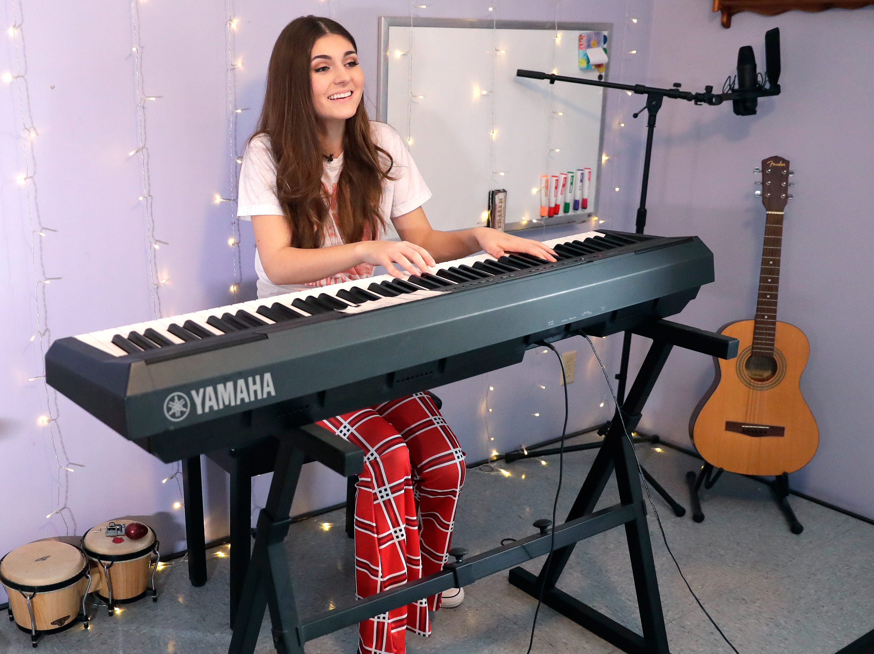 Franki Moscato, a 17-year-old singer/songwriter, plays piano in her room on Feb. 28, 2019, at her family's home in Oshkosh, Wis.