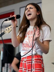 "Franki Moscato rehearses for her suicide awareness event Feb. 28, 2019, at the Menominee Nation Arena in Oshkosh, Wis., that also celebrated her 100th show as a singer and featured the premiere of her ""I Will Rise"" music video."