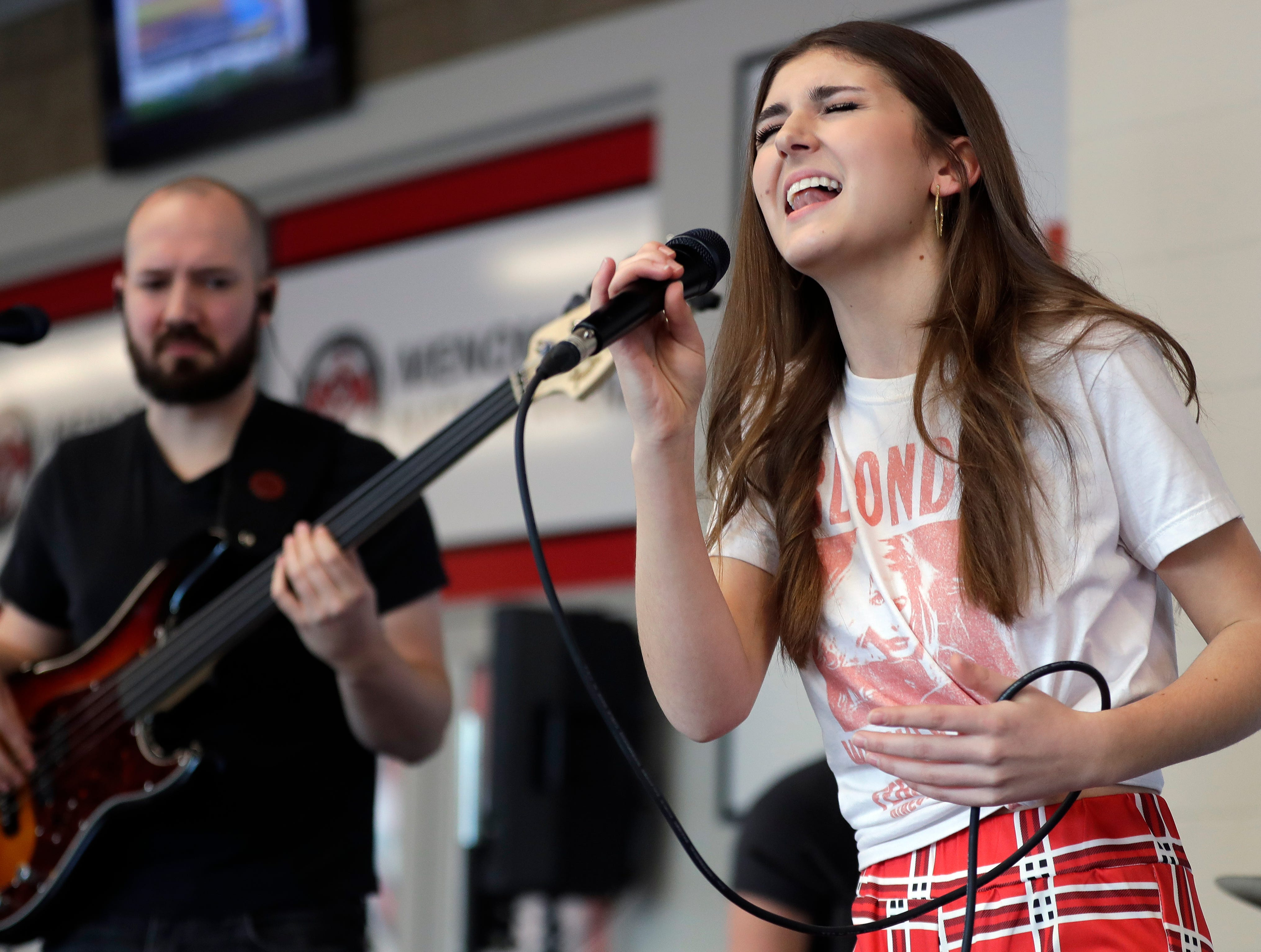 """Franki Moscato rehearses for her suicide awareness event Feb. 28, 2019, at the Menominee Nation Arena in Oshkosh, Wis. that also celebrated her 100th show as a singer and featured the premiere of her """"I Will Rise"""" music video. Sarah Kloepping/USA TODAY NETWORK-Wisconsin"""