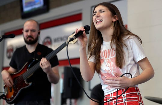 "Franki Moscato rehearses for her suicide awareness event Feb. 28, 2019, at the Menominee Nation Arena in Oshkosh, Wis. that also celebrated her 100th show as a singer and featured the premiere of her ""I Will Rise"" music video. Sarah Kloepping/USA TODAY NETWORK-Wisconsin"
