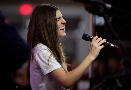 "Franki Moscato performs at her suicide awareness event Feb. 28, 2019, at the Menominee Nation Arena in Oshkosh, Wis., that also celebrated her 100th show as a singer and featured the premiere of her ""I Will Rise"" music video."