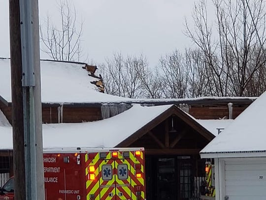 The roof of the Ye Old Goat vintage store is seen Sunday, March 10, 2019, after it collapsed. Fire crews believe heavy, wet snow overnight led to the collapse.