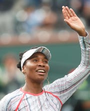 Venus Williams waves to her fans after her win over Christina McHale on Stadium One at the 2019 BNP Paribas Open at Indian Wells Tennis Garden on March 11, 2019. Williams won the third round match 6-2, 7-5.