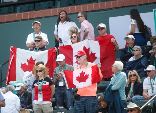 Fans of Canadian Felix Auger-Aliassime celebrates his win against Stefanos Tsitsipas, of Greece on Stadium One at the 2019 BNP Paribas Open at Indian Wells Tennis Garden on March 9, 2019. Auger-Aliassime won their second round match in two sets 6-4, 6-2.