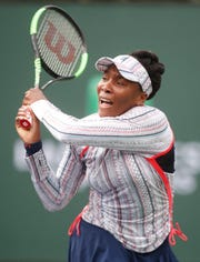 Venus Williams returns a backhand to Christina McHale on Stadium One at the 2019 BNP Paribas Open at Indian Wells Tennis Garden on March 11, 2019. Williams won the third round match 6-2, 7-5.