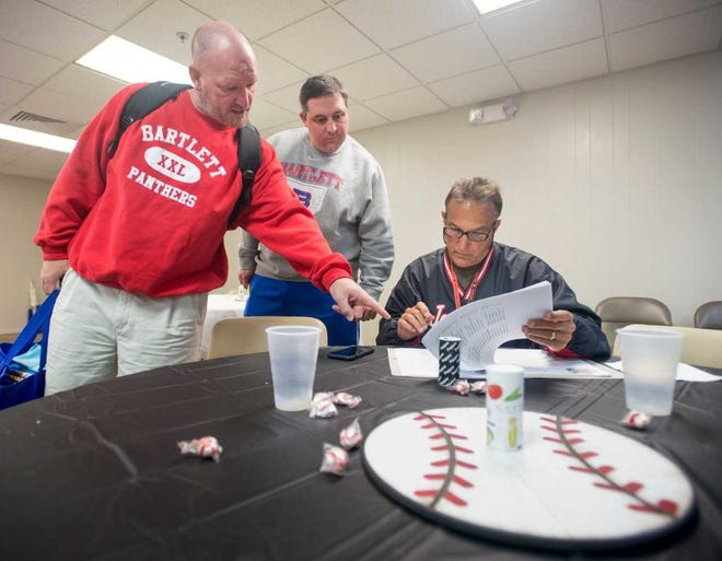 West Florida High baseball coach Marc Conti, shown going over schedule for a past year's tournament, has his team off to strong start.