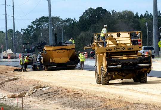 Work continues Friday to widen Nine Mile Road. Under a proposed road swap with Escambia County, the state would take control of a section of Beulah Road that runs from Mobile Highway, crossing Nine Mile Road, to 1-10.