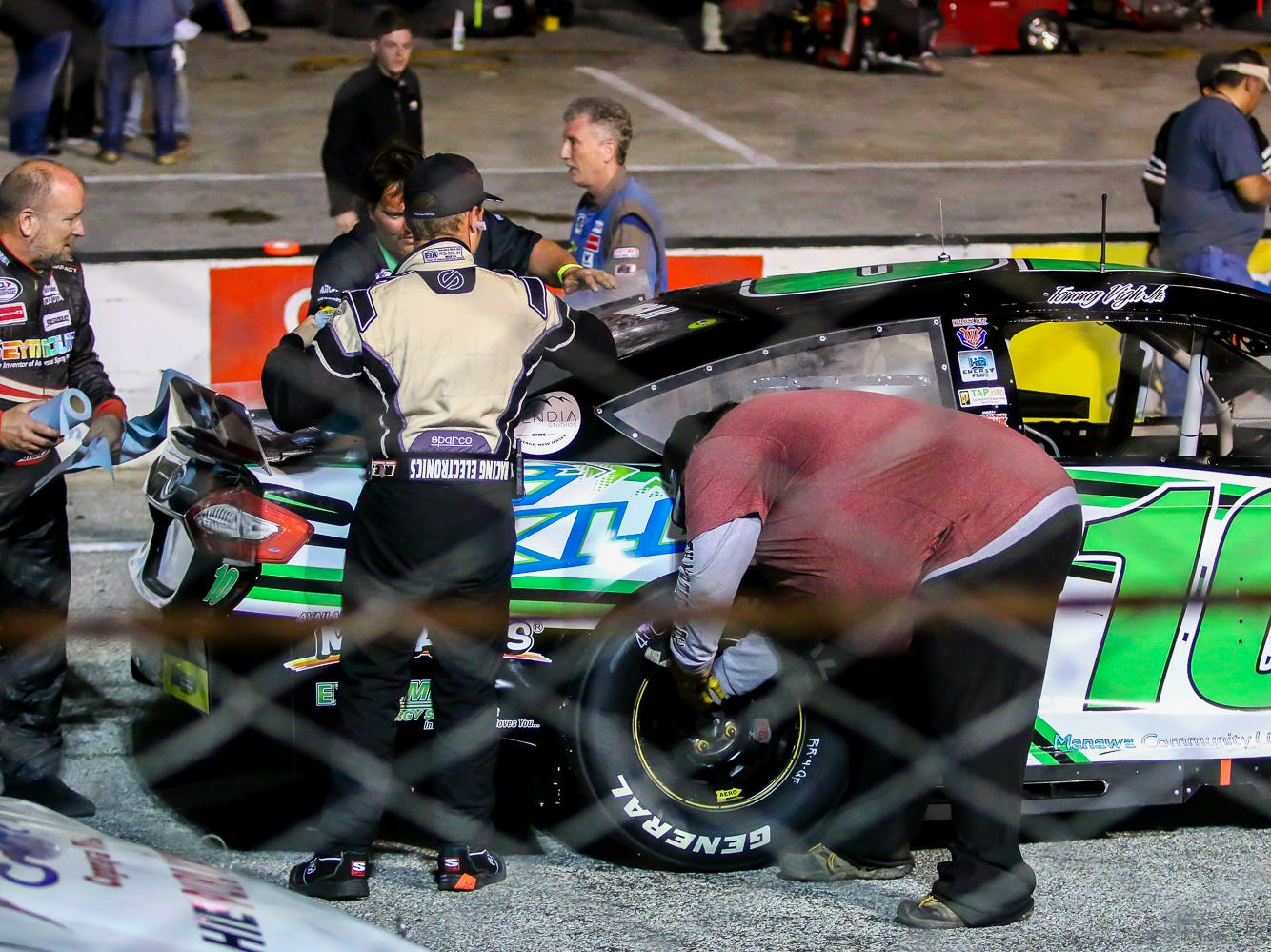 Crew members make sure the car of Tommy Vigh Jr. (10) is ready before the start of the ARCA Pensacola 200 race presented by Inspectra Thermal Solutions on Saturday, March 9, 2019, at Five Flags Speedway. Michael Self, of Salt Lake City, won the race.