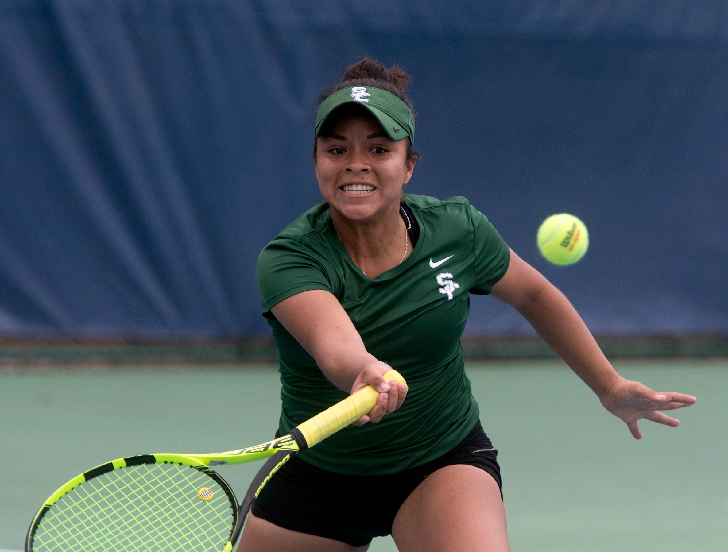 Patricia Panta from Seward County Community College, returns the serve from the Abraham Baldwin Agricultural College team during doubles play in the Western Gate Tennis Invitational tournament at UWF on Monday, March 11, 2019. Seward won the match 8-3.