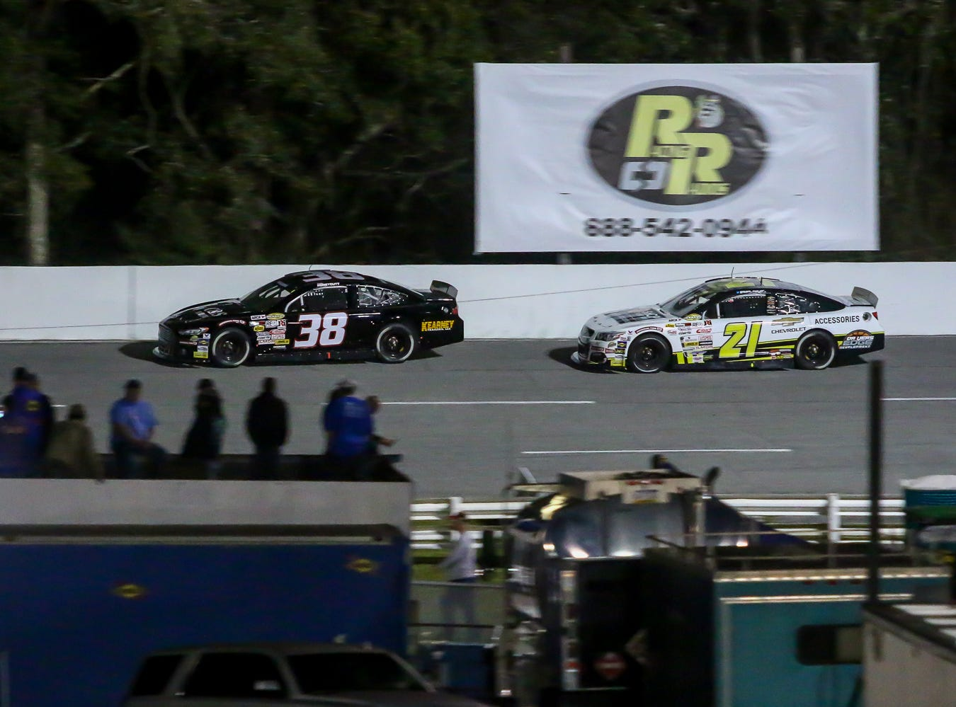 Fans watch as Kaden Honeycut (38) and Sam Mayer (21) make their way around the track during the ARCA Pensacola 200 race presented by Inspectra Thermal Solutions on Saturday, March 9, 2019, at Five Flags Speedway. Michael Self, of Salt Lake City, won the race.