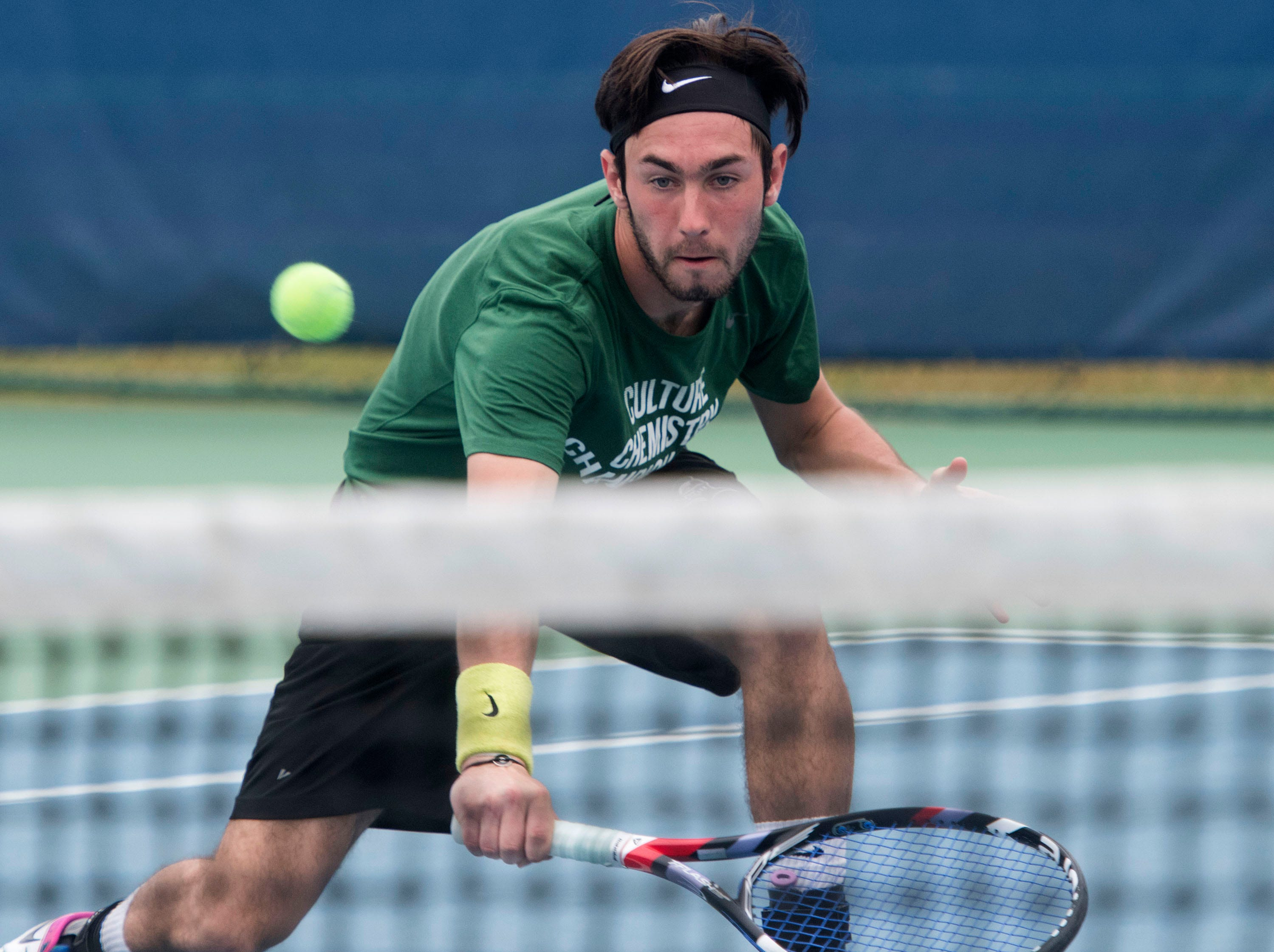Hugo Lobo plays the net during doubles play against Abraham Baldwin Agricultural College during the Western Gate Tennis Invitational tournament at UWF on Monday, March 11, 2019. Seward won the match 8-6.