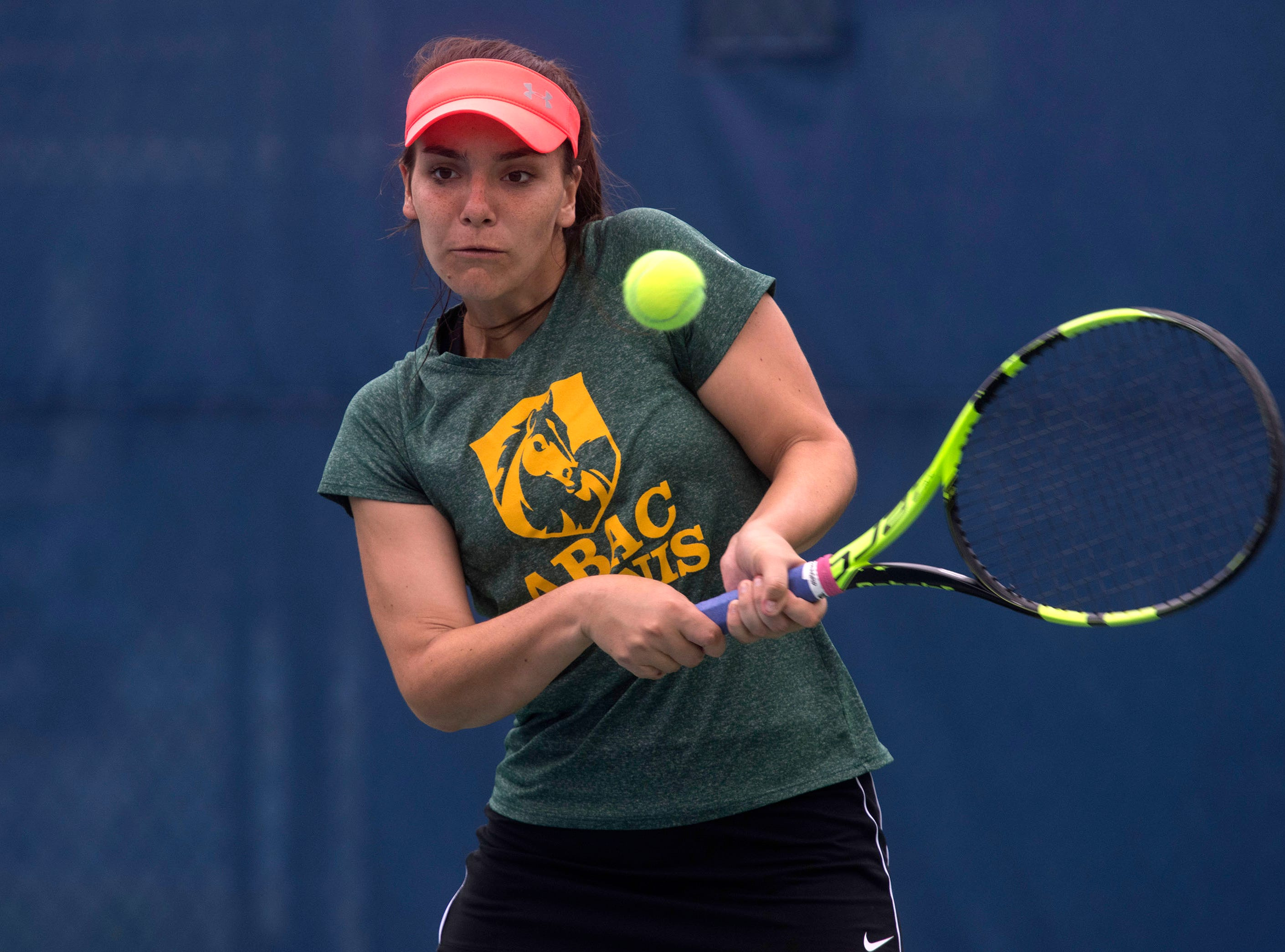 Agustina Diaz from Abraham Baldwin Agricultural College, returns the serve from the Seward County Community College team during doubles play in the Western Gate Tennis Invitational tournament at UWF on Monday, March 11, 2019. Seward won the match 8-3.