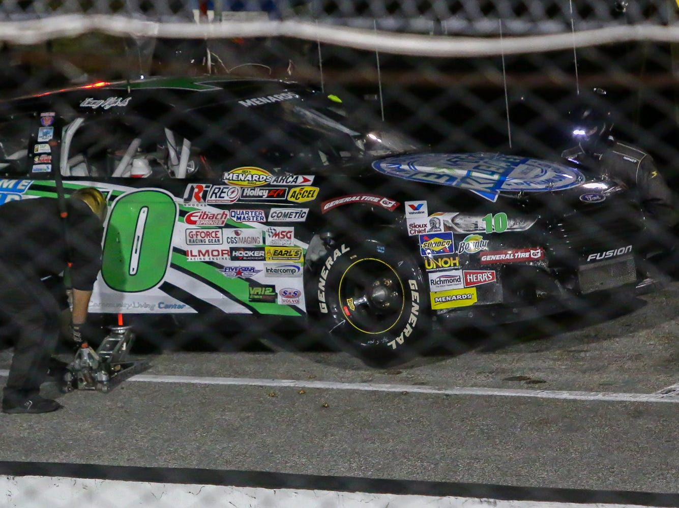 Crew members work on the car of Tommy Vigh Jr. (10) during a pit stop in the ARCA Pensacola 200 race presented by Inspectra Thermal Solutions on Saturday, March 9, 2019, at Five Flags Speedway. Michael Self, of Salt Lake City, won the race.