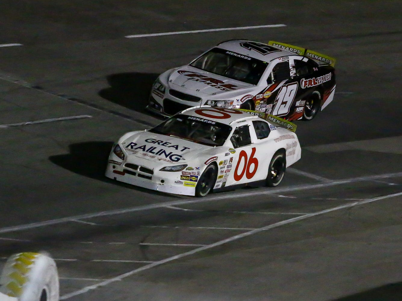 Raphael Lessard (19) and Tim Richmond (06) make their way around the track during the ARCA Pensacola 200 race presented by Inspectra Thermal Solutions on Saturday, March 9, 2019, at Five Flags Speedway. Michael Self, of Salt Lake City, won the race.