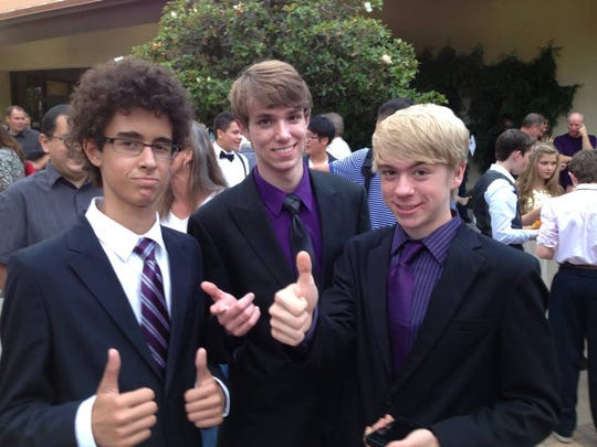 Ethan Cruz, Sawyer and Landon Hooser at eighth-grade graduation.