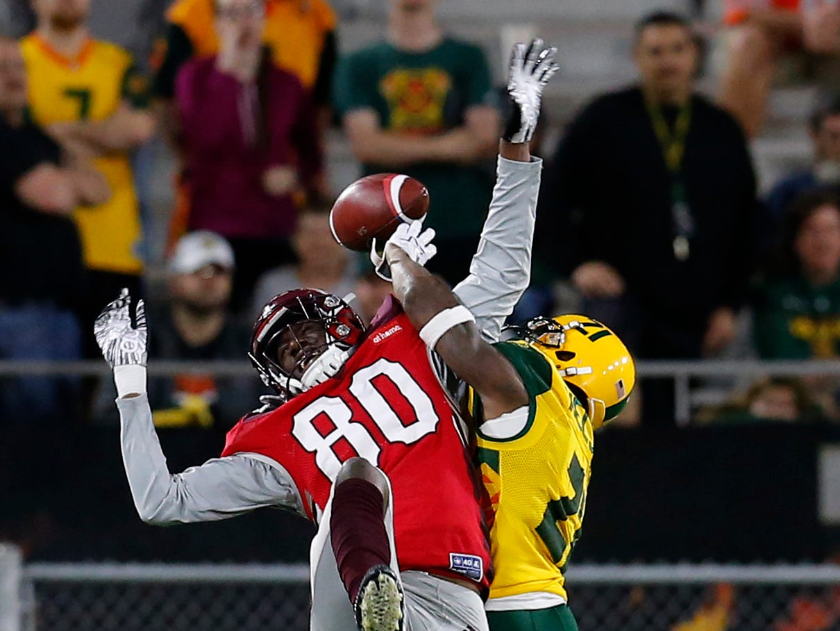 Arizona Hotshots defensive back Robert Nelson (21) breaks up the pass intended for San Antonio Commanders wide receiver Josh Stewart (80) in the second half during an AAF football game, Sunday, March 10, 2019, at Sun Devil Stadium in Phoenix. San Antonio defeated Arizona 29-25. (AP Photo/Rick Scuteri)