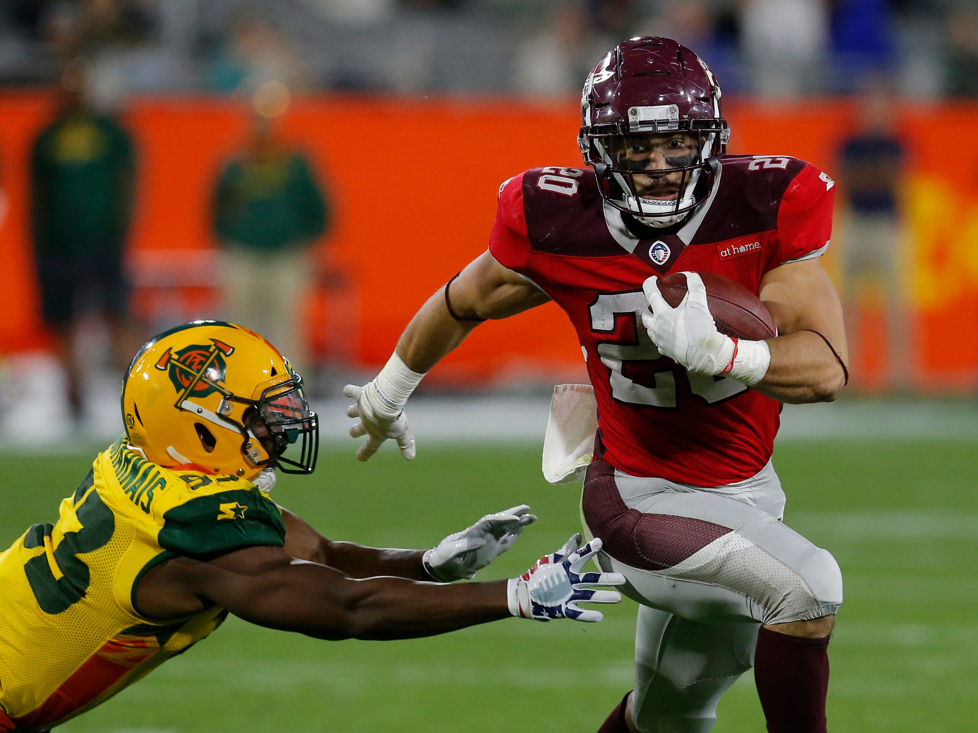 San Antonio Commanders running back Kenneth Farrow, II (20) breaks a tackle by Arizona Hotshots defensive tackle Siupeli Anau (93) in the second half during an AAF football game, Sunday, March 10, 2019, at Sun Devil Stadium in Phoenix. San Antonio defeated Arizona 29-25. (AP Photo/Rick Scuteri)