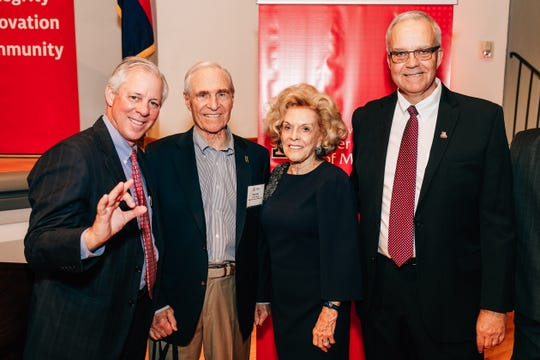 Karl and Stevie Ellers pose for a picture with UA President Robert C. Robbins and Eller College of Management Dean Paulo Goes