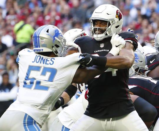 Cardinals tight end Jermaine Gresham (84) blocks Lions linebacker Christian Jones (52) during the first half of a game Dec. 9 at State Farm Stadium.