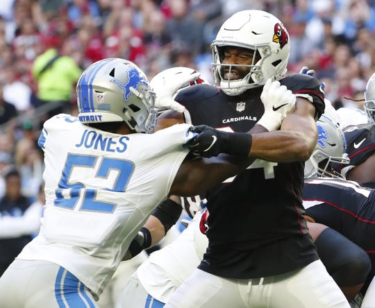 Cardinals tight end Jermaine Gresham (84) blocks Lions linebacker Christian Jones (52) during the first half of a game Dec. 9 at State Farm Stadium.