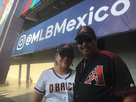 Gelacio Ramirez and Adriana Ramirez are baseball fans in Monterrey, Mexico.