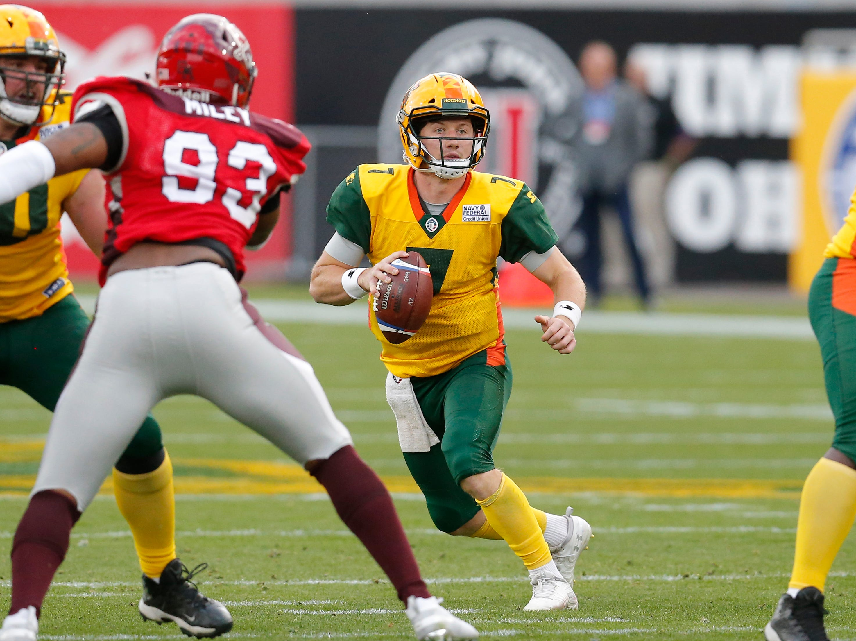 Arizona Hotshots quarterback John Wolford (7) looks down field against the San Antonio Commanders in the first half during an AAF football game, Sunday, March 10, 2019, at Sun Devil Stadium in Phoenix. (AP Photo/Rick Scuteri)