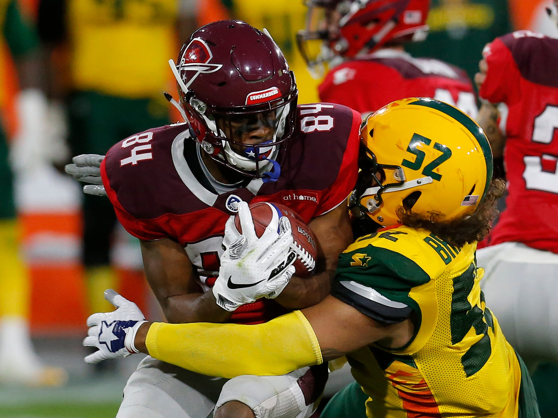 Arizona Hotshots linebacker Carl Bradford (52) stops San Antonio Commanders wide receiver Greg Ward, Jr. (84) from getting a first down in the second half during an AAF football game, Sunday, March 10, 2019, at Sun Devil Stadium in Phoenix. San Antonio defeated Arizona 29-25. (AP Photo/Rick Scuteri)