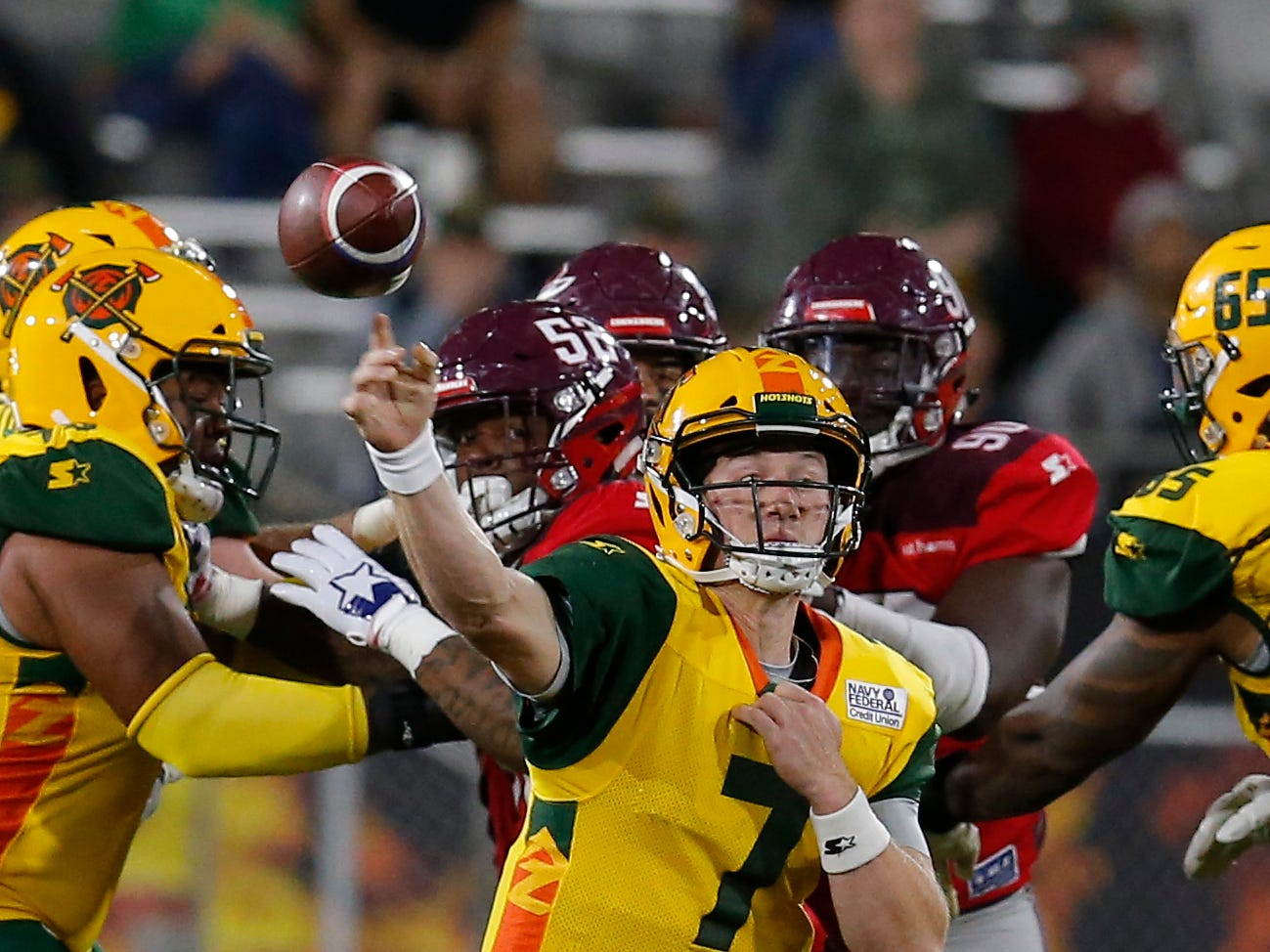 Arizona Hotshots quarterback John Wolford (7) throws down field against the San Antonio Commanders pressure in the second half during an AAF football game, Sunday, March 10, 2019, at Sun Devil Stadium in Phoenix. San Antonio defeated Arizona 29-25. (AP Photo/Rick Scuteri)
