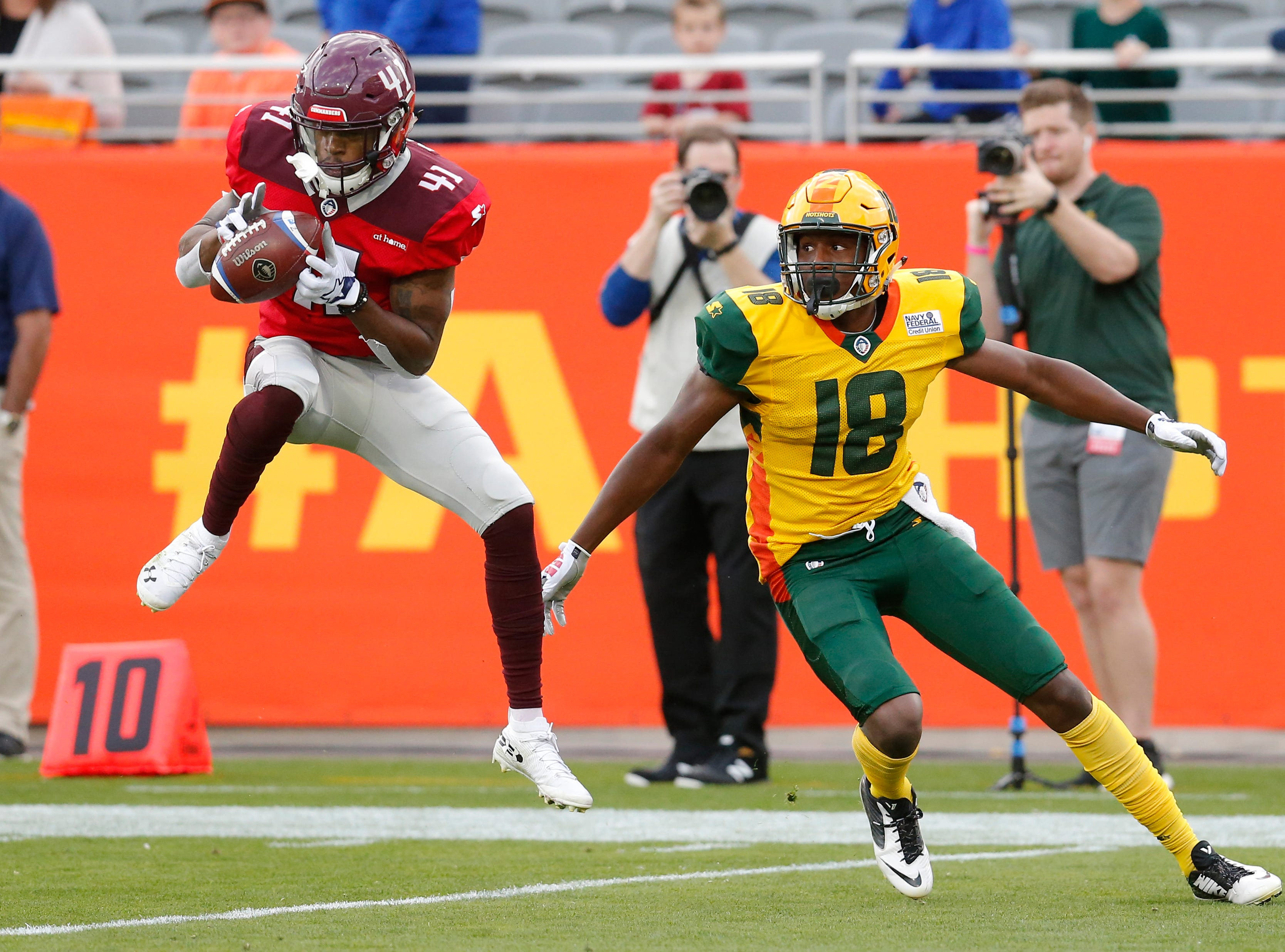 San Antonio Commanders defensive back De'Vante Bausby (41) intercepts the ball that was intended for Arizona Hotshots wide receiver Marquis Bundy (18) in the first half during an AAF football game, Sunday, March 10, 2019, at Sun Devil Stadium in Phoenix. (AP Photo/Rick Scuteri)