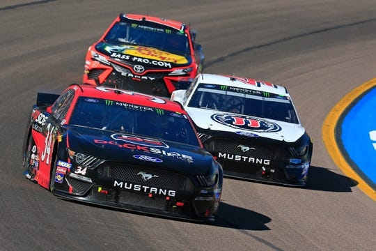 Michael McDowell, driver of the #34 Dockside Logistics Ford, leads a pack of cars during the Monster Energy NASCAR Cup Series TicketGuardian 500 at ISM Raceway on March 10, 2019 in Avondale, Arizona.