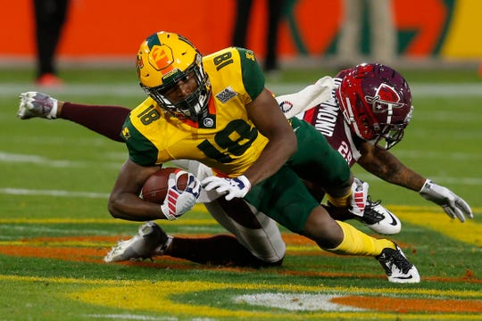 Arizona Hotshots wide receiver Marquis Bundy avoids a tackle by San Antonio Commanders defensive back Kurtis Drummond (25) in the second half during an AAF football game, Sunday, March 10, 2019, at Sun Devil Stadium in Phoenix. San Antonio defeated Arizona 29-25. (AP Photo/Rick Scuteri)