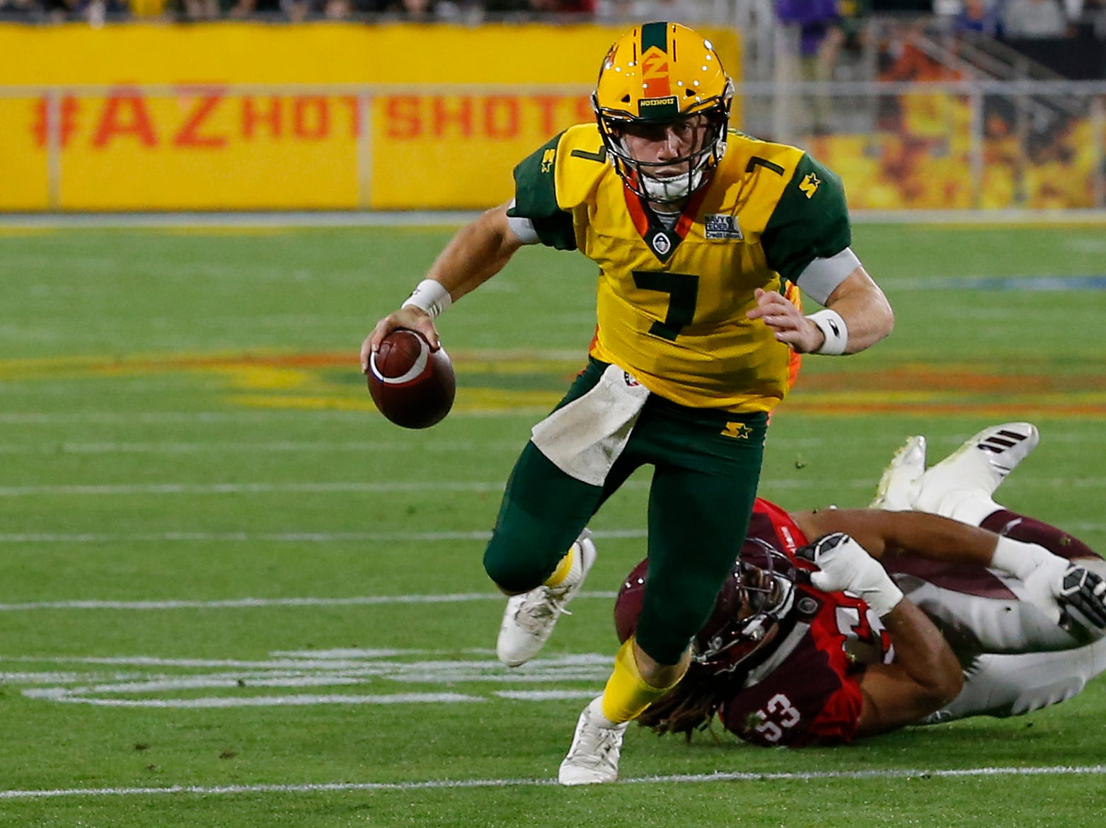 Arizona Hotshots quarterback John Wolford (7) gets pressured by San Antonio Commanders linebacker Austin Larkin (53) in the second half during an AAF football game, Sunday, March 10, 2019, at Sun Devil Stadium in Phoenix. San Antonio defeated Arizona 29-25. (AP Photo/Rick Scuteri)