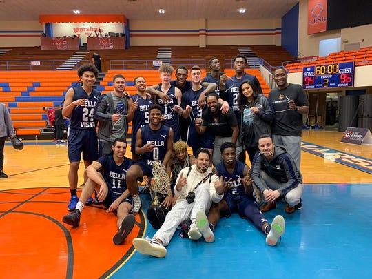 Bella Vista Prep basketball team celebrates its championship victory over Spire Academy on March 10 in Benton, Kentucky.