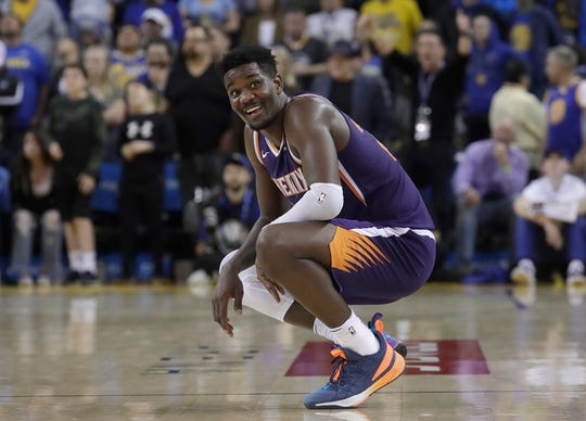 Phoenix Suns center Deandre Ayton smiles during the second half of his team's NBA basketball game against the Golden State Warriors in Oakland, Calif., Sunday, March 10, 2019. (AP Photo/Jeff Chiu)