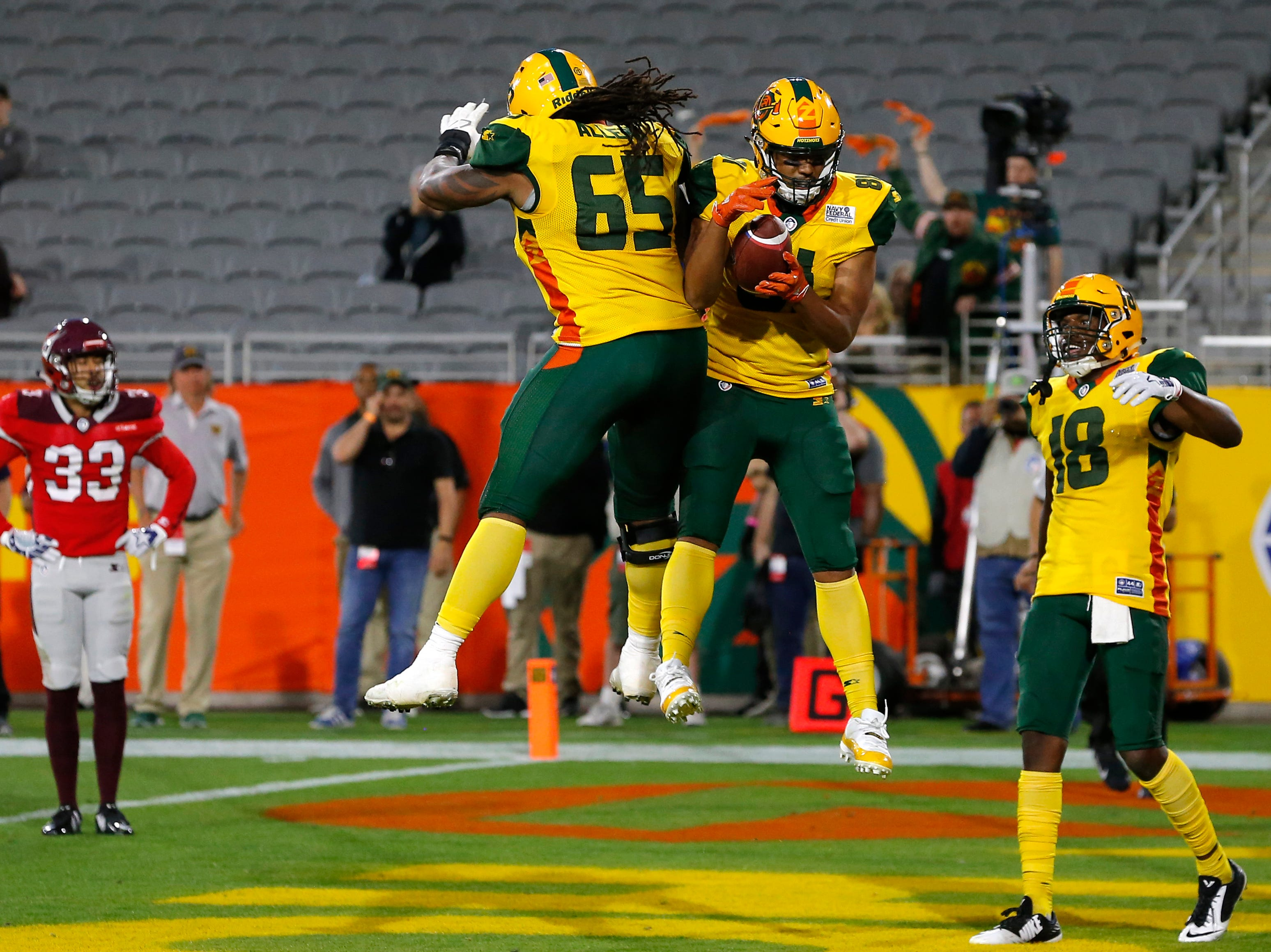 Arizona Hotshots tight end Thomas Duarte (81) celebrates with Josh Allen (65) after scoring a touchdown against the San Antonio Commanders in the second half during an AAF football game, Sunday, March 10, 2019, at Sun Devil Stadium in Phoenix. San Antonio defeated Arizona 29-25. (AP Photo/Rick Scuteri)