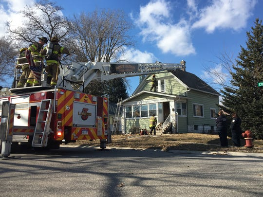 Firefighters respond to a structure fire Monday afternoon on Connor Street in Port Huron.