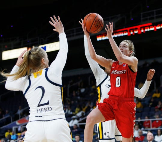 Marist's Grace Vander Weide takes a shot over Quinnipiac's Taylor Herd during the MAAC championship in Albany on March 11 2019.